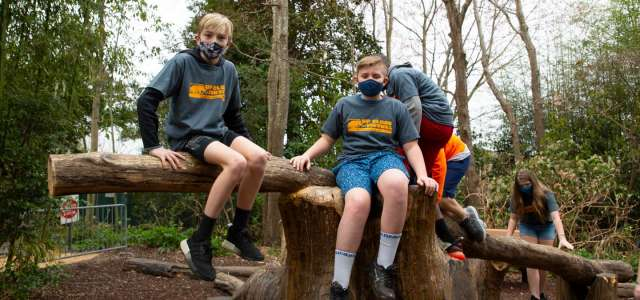 Camp kids on Gorilla Climber wearing masks during COVID-19